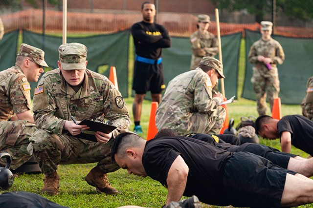 Staff Sgt. Gabriel Wright, a signals intelligence analyst with the 780th Military intelligence Brigade, grades the Hand-Release Push-Up event as part of Army Combat Fitness Test Level II Grader validation training, held at Fort Meade, Md.,  May 17, 2019. A mobile training team from Fort Gordon's Cyber Center of Excellence NCO Academy provided the training by teaching, coaching, and administering the ACFT to 114 NCOs.