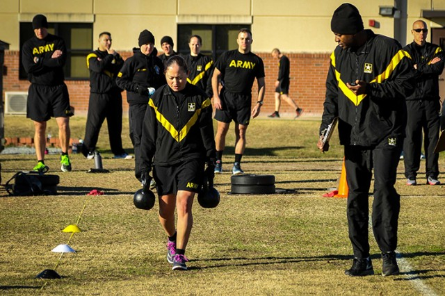 U.S. Army 1st Sgt. Martaliz Merced-Santana, assigned to Headquarters and Headquarters Detachment, 519th Military Intelligence Battalion, 525th Military Intelligence Brigade, executes the Sprint Drag Carry event during the field testing of the Army Combat Fitness Test at Fort Bragg, N.C., Jan. 9, 2019.