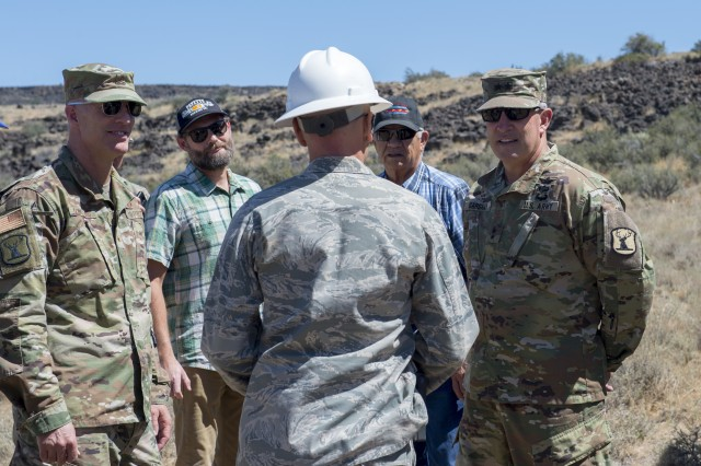 Maj. Gen. Mike Garshak, the adjutant general for the state of Idaho, and Brig. Gen Tim Donnellan, the assistant adjutant general-air, visits with the Idaho National Guard, Civil Engineer Squadron, during a VIP day while building access roads for their Innovative Readiness Training at the Shoshone-Paiute Reservation. The IRT provides joint training opportunities to increase deployment readiness while benefitting communities.