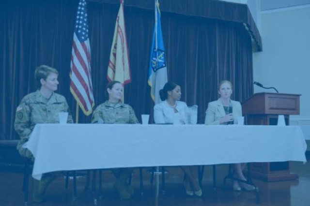 A three-member panel moderated by Col. Heidi Urben (seated, far left) of the 704th MI Brigade included Command Sgt. Maj. Sheryl Lyon, retired Chief Master Sgt. Arlene Murray, and Jenna Seidel of NSA./ Nicole Munchel for the Baltimore/Baltimore Sun Media Group