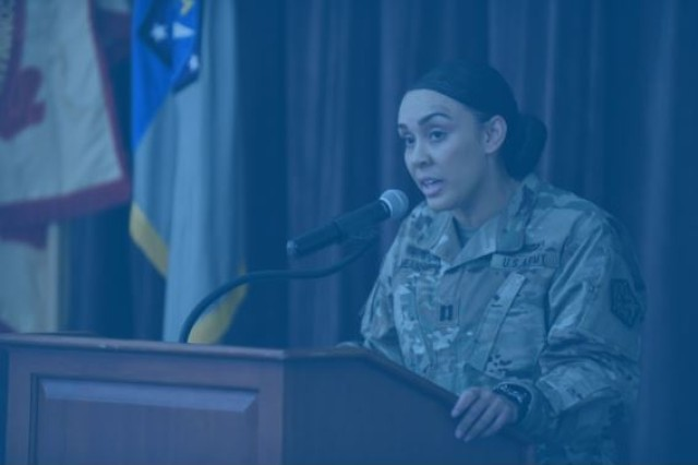 Alexis Means, commander of C Company, 741st MI Battalion, recites an original poem. / Nicole Munchel for the Baltimore/Baltimore Sun Media Group