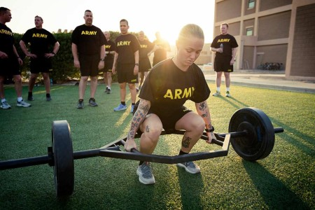 Soldiers with 401st Army Field Support Battalion-Kuwait, performs the three Repetition Maximum Deadlift element of the new Army Combat Fitness Test during familiarization training at Camp Arifjan, Kuwait, Aug. 17, 2019.