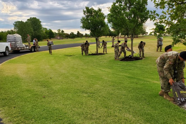 D Battery, 1st Battalion, 79th Field Artillery basic combat training trainees and cadre perform lawn maintenance Aug. 14, 2019, at the Fort Sill National Cemetery.