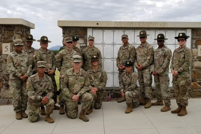 1-79th FA cadre cluster around the final resting place of 1st Lt. Cale Brewer's grandmother at the Fort Sill National Cemetery. Battalion members performed community service at the cemetery Aug. 14, 2019, continuing their commitment to honor those buried there.