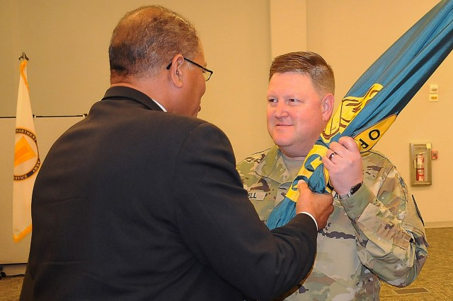 Army Logistics University President Michael Williams passes his organization's colors to incoming commandant, Col. Brent D. Coryell, during an assumption of responsibility ceremony Aug. 20 in Heiser Hall. Coryell comes to Fort Lee from Camp Humphries, South Korea, where he was deputy commander at Defense Logistics Agency Indo-Pacific.
