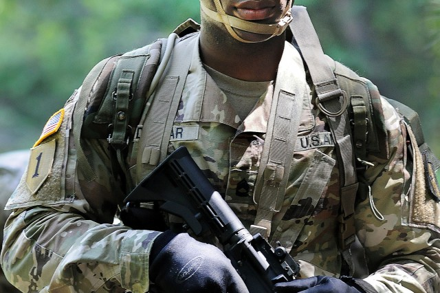 Sgt. 1st Class Frank Dunbar stands ready to compete in one of the situational training exercise lanes included in the 2019 CASCOM Drill Sergeant of the Year Competition July 1.  Dunbar, assigned to Tango Company, 266th QM Battalion, and representing the Quartermaster School, was declared the winner of the overall event.