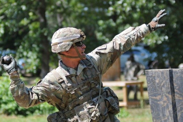 Staff Sgt. Michael HilgendorfPagaduan from Charlie Company, 832nd Ordnance Battalion, tosses a dummy grenade at Training Area 18 during the Drill Sergeant of the Year competition July 2.