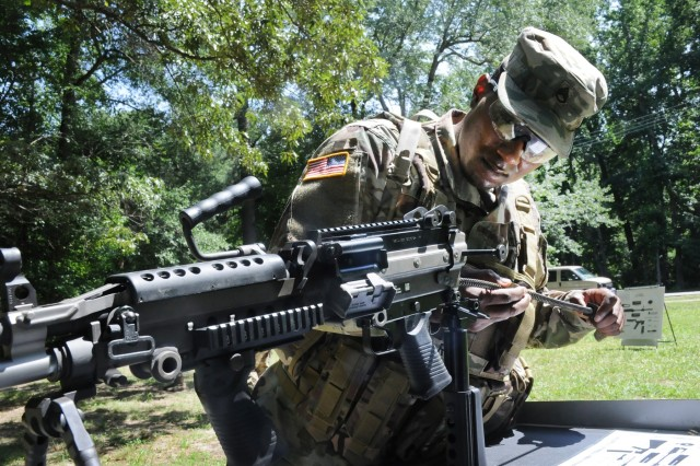 Staff Sgt. Allen Rice from Alpha Company, 244th Quartermaster Battalion, reassembles an M249 submachine gun during the Drill Sergeant of the Year Competition July 1 at Training Area 34.