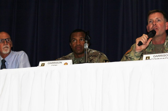 Wayne Bardell, Fort Rucker Directorate of Family, Morale, Welfare and Recreation director, Command Sgt. Maj. Jasper Johnson, garrison command sergeant major, and Col. Whitney B. Gardner, garrison commander, speak at the town hall Aug. 22 at the Spiritual Life Center.