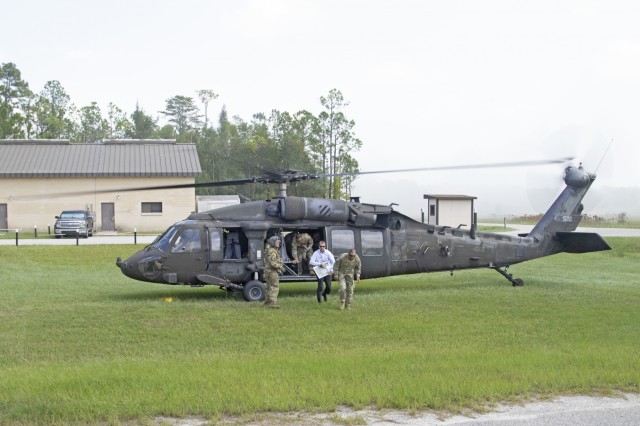 General Michael X. Garrett, commander of the United States Army Forces Command, gets out of a UH-60 Black Hawk to visit 3rd Infantry Division in Fort Stewart, Georgia., Aug. 13, 2019. Garrett visited the installation discuss Soldier readiness and ongoing operations. (U.S. Army photo Sgt. Zoe Garbarino/Released)