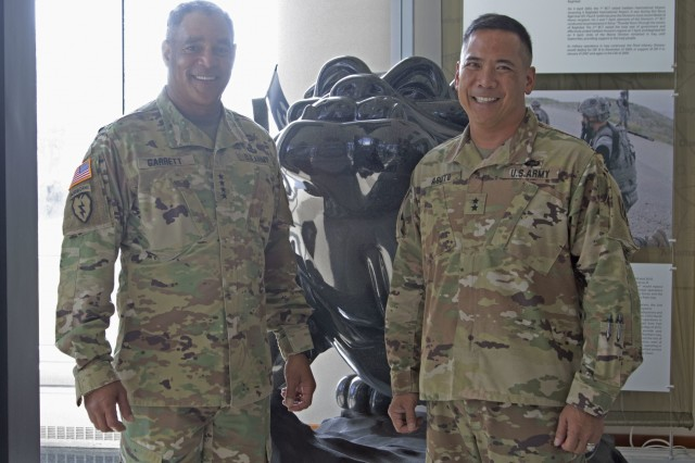 General Michael X. Garrett, commander of the United States Army Forces Command, stands alongside Maj. Gen. Tony Aguto, commander of the 3rd Infantry Division, in Fort Stewart, Georgia., Aug. 13, 2019. Garrett visited the installation discuss Soldier readiness and ongoing operations. (U.S. Army photo Sgt. Zoe Garbarino/Released)