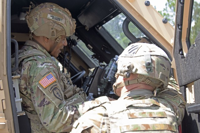 General Michael X. Garrett, commander of the United States Army Forces Command, looks inside a M1 Abrams in Fort Stewart, Georgia., Aug.13, 2019. Garrett visited 3rd Infantry Division to discuss Soldier readiness and ongoing operations. (U.S. Army photo Sgt. Zoe Garbarino/Released)