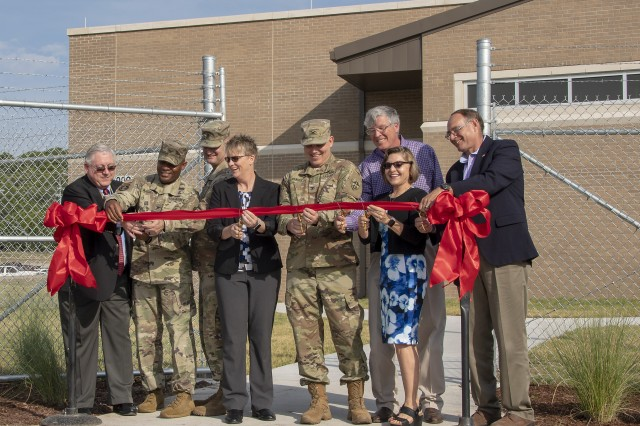 (From left-to-right) Mr. John W. Diem, U.S. Army Operational Test Command (OTC) Executive Director; Col. Ronald R. Ragin, OTC Commander; Command Sgt. Maj. William A. Justice, OTC Command Sergeant Major; Ms. Bonnie A. McIlrath, Director, Test Technology Directorate, OTC; Col. Patrick E. Curry, Director, Mission Command Test Directorate, OTC; Mr. William J. McKiernan, Deputy Director, Maneuver Test Directorate, OTC; Ms. Sara A. Van Dusen, Deputy Director & Senior Test Manager, Aviation Test Directorate, OTC; and Mr. William G. Adams, Director, Methodology & Analysis Test Directorate, OTC, join together in the ribbon cutting to officially open the equipment testing unit's new Technology Integration Center Wednesday, Aug. 28, 2019.