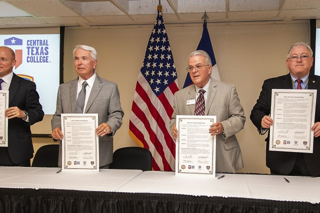 "(From left-to-right) Killeen ISD Superintendent Dr. John Craft; Central Texas College Chancellor Jim Yeonopolus; Texas A&M University-Central Texas President Marc Nigliazzo; and Mr. John W. Diem, Executive Director of the U.S. Army Operational Test Command, display the ""Cyber Information Sharing Pledge"" Wednesday, Aug. 28, 2019, which is expected to build a critical foundation of trust, partnership and commitment that will be central as the four entities enter future collaborative endeavors."