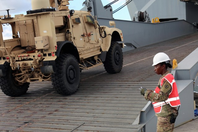 Sgt. Roxanne Ballantyne, 1174th Transportation Battalion cargo specialist, keeps a piece count of cargo entering the stern ramp on the USNS Brittin during upload operations at Pearl Harbor on Aug 10.
