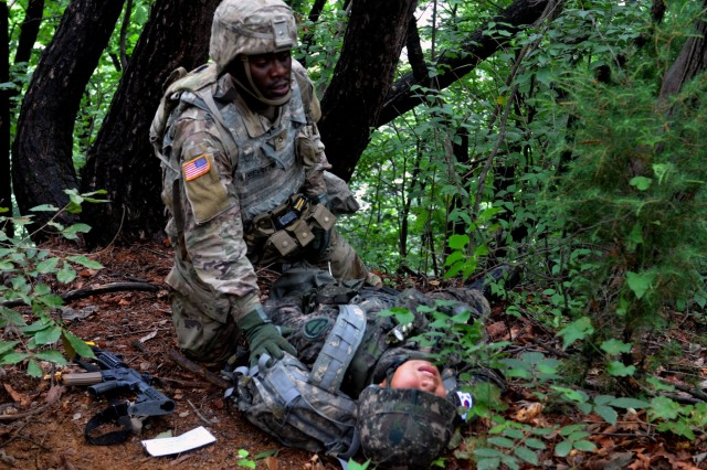 CAMP HOVEY, Republic of Korea - A Soldier with 6th Squadron, 9th Cavalry Regiment, 3rd Brigade Combat Team, 1st Cavalry Division provides medical care to a Republic of Korea Army Soldier as part of the Saber First Responder Course testing, August 16. The weeklong course teaches Soldiers how to provide extended care to the wounded in austere environments. (Photo by KCpl. Song, Junghwan, 3/1CAV Public Affairs)