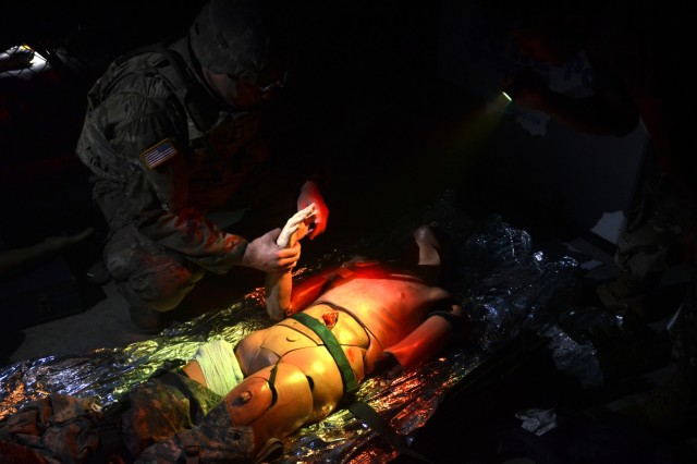 CAMP HOVEY, Republic of Korea - A Soldier with 6th Squadron, 9th Cavalry Regiment, 3rd Brigade Combat Team, 1st Cavalry Division provides medical care to a simulated casualty in near black-out conditions as part of the Saber First Responder Course testing, August 16. The week-long course teaches Soldiers how to provide extended care to the wounded in austere environments. (Photo by KCpl. Song, Junghwan, 3/CAV Public Affairs)