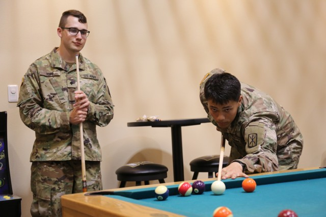Soldiers play pool at Camp Zama's newly opened Warrior Zone after a ribbon-cutting ceremony Aug. 23 inside the Community Recreation Center.