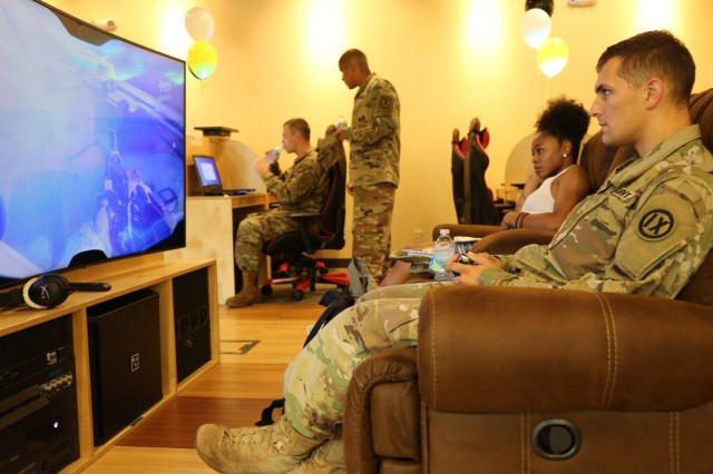 Soldiers play video games at Camp Zama's newly opened Warrior Zone after a ribbon-cutting ceremony Aug. 23 inside the Community Recreation Center.