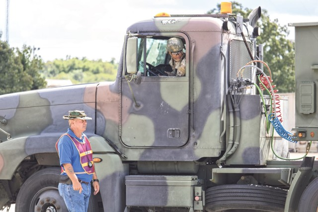 Soldiers from 58th Transportation Battalion demonstrate their skills to onlookers during the recent visit from the Federal Motor Carrier Safety Administration Tuesday. Officials are working to allow service members to get a Commercial Driver's License easier based on skills and training gained in the military.