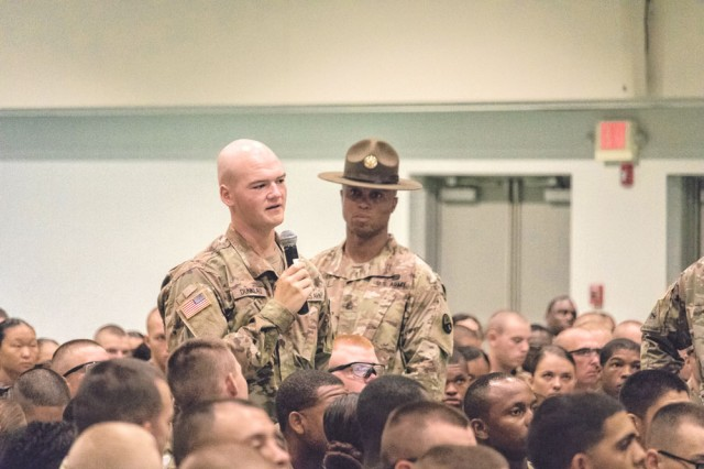 Pfc. Jacob Dunklau asks a question during the question and answer session with the Federal Motor Carrier Safety Administration.