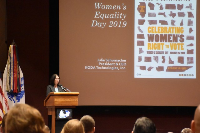 "Julie Schumacher, former deputy to the commander of U.S. Army Space and Missile Defense Command speaks at the Team Redstone Women's Equality Day at the Bob Jones Auditorium Aug. 28. This year's theme is ""Celebrating Women's Right to Vote."" (U.S. Army photo by Ronald Bailey)"