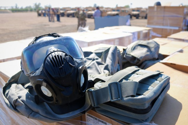 M50/M51 Joint Service General Purpose Masks are boxed and ready to go as part of the Organizational Clothing and Individual Equipment package the Iraqi Army is receiving during a Counter-Daesh Train and Equip Fund (CTEF) Divestment at Camp Taji, Iraq, June 29, 2019. The 529th Support Battalion conducts CTEF divestments to assist Iraqi Security Forces strengthen their national security. The Coalition is in Iraq by invitation of, and operates in close coordination with, the Government of Iraq.  (U.S. Army National Guard photo by Sgt. Roger Jackson)