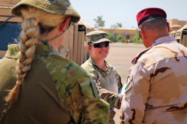 2nd Lt. Briana Nisbet, 183d Maintenance Company Counter-Daesh Train and Equip Fund (CTEF) officer in charge, shakes hands with Iraqi Army Staff Brigadier General Qais Saim Jaber Abood Al 'Khafaji, 55th Brigade, 17 Division, after verifying mobility package during a CTEF Divestment at Camp Taji, Iraq, June 29, 2019. The 183d Maintenance Company, 529th Support Battalion, conducts CTEF divestments to assist Iraqi Security Forces strengthen their national security. The Coalition is in Iraq by invitation of, and operates in close coordination with, the Government of Iraq.   (U.S. Army National Guard photo by Sgt. Roger Jackson)