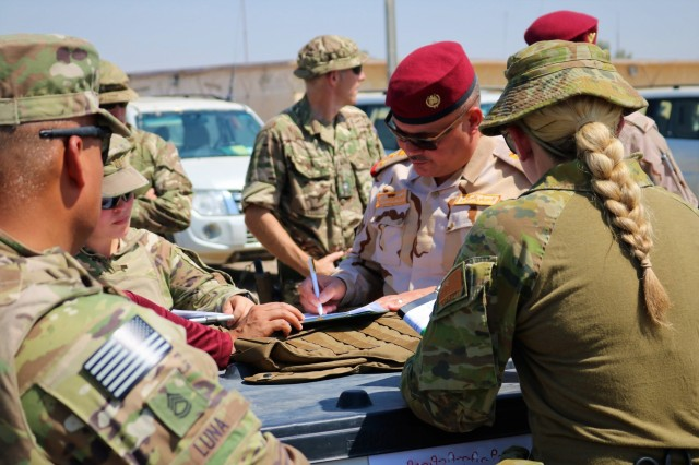 IraIraqi Army Staff Brigadier General Qais Saim Jaber Abood Al 'Khafaji, 55th Brigade, 17 Division, reviews and signs documentation for an Organizational Clothing and Individual Equipment package during a Counter-Daesh Train and Equip Fund (CTEF) Divestment at Camp Taji, Iraq, June 29, 2019. The 529th Support Battalion conducts CTEF divestments to assist Iraqi Security Forces strengthen their national security. The Coalition is in Iraq by invitation of, and operates in close coordination with, the Government of Iraq.   (U.S. Army National Guard photo by Sgt. Roger Jackson)