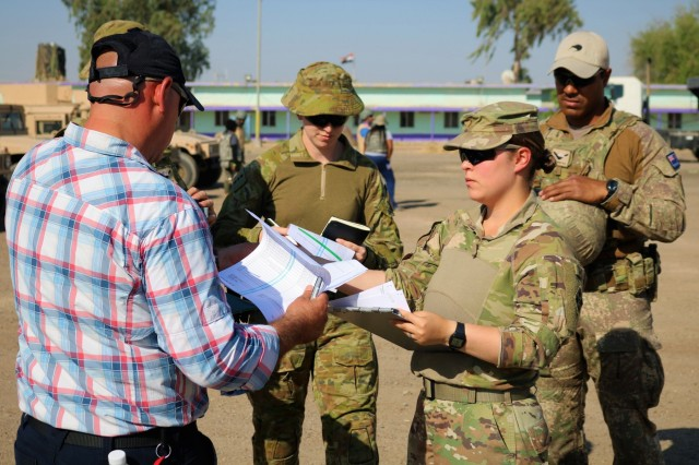 U.S. Army 2nd Lt. Briana Nisbet, 183d Maintenance Company Counter-Daesh Train and Equip Fund (CTEF) officer in charge, and Australian Army Capt. Kelly Strickland, Aid and Assistance Team, review documentation and perform a quick inventory during a CTEF Divestment at Camp Taji, Iraq, June 29, 2019. The 183d Maintenance Company, 529th Support Battalion, conducts CTEF divestments to assist Iraqi Security Forces strengthen their national security.  The Coalition is in Iraq by invitation of, and operates in close coordination with, the Government of Iraq. (U.S. Army National Guard photo by Sgt. Roger Jackson)
