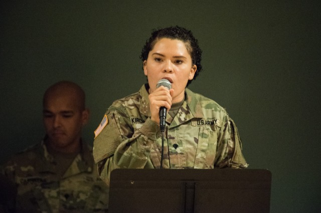Spc. Princess Kirchner, vocalist, and the 399th Army Band entertain the audience Tuesday during Fort Leonard Wood's 2019 Women's Equality Day Observance and Luncheon.