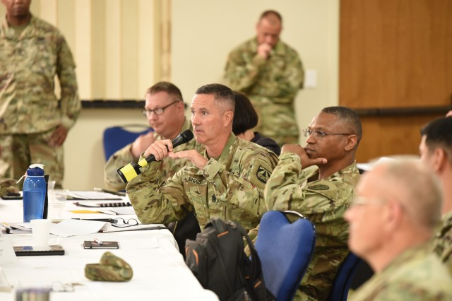 Command Sergeant Major Paul Biggs, Future and Concepts Center, Command Sergeant Major, U.S. Army Futures Command (center left), asking a question while Command Sergeant Major Michael Gragg, U.S. Army Medical Command, Command Sergeant Major looks on.