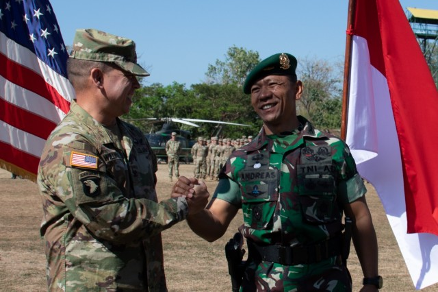 Col. Kevin Williams, commander of the 2nd Infantry Brigade Combat Team , 25th Infantry Division, and Col. Andreas Nanag, commander of the Tentara Nasional Indonesian AD 9th Brigade, shake hands after the closing ceremony on Aug. 30, 2019, at Dodiklatpur Army Base, Indonesia. Garuda Shield is an annual, bilateral military partnership sponsored by the U.S. Army Pacific and hosted annually by Tentara Nasional Indonesia. (U.S. Army photo by Maj. Leah Ganoni, 2IBCT, 25th ID PAO)