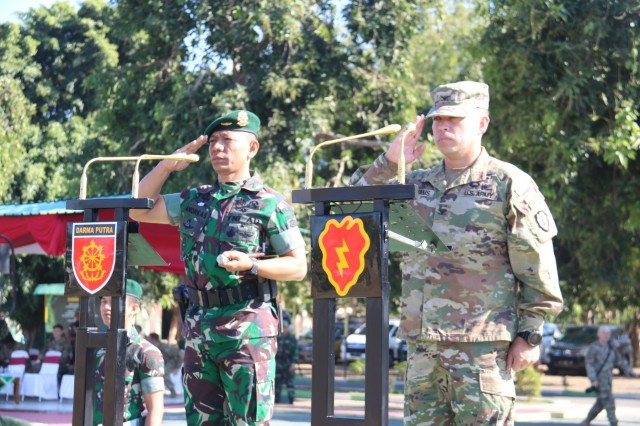 Col. Kevin Williams, commander of the 2nd Infantry Brigade Combat Team , 25th Infantry Division, and Col. Andreas Nanag, commander of the Tentara Nasional Indonesian AD 9th Brigade, salute a formation of U.S. and Indonesian forces during the 2019 Garuda Shield closing ceremony Aug. 30, 2019, at Dodiklatpur Army Base, Indonesia. Garuda Shield is an annual, bilateral military partnership sponsored by the U.S. Army Pacific and hosted annually by Tentara Nasional Indonesia. (TNI-AD photo by 2nd Private Wahydi, 9th Brigade)
