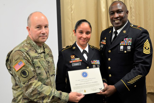 White Sands Missile Range Commander Col. David C. Trybula, left, and 1st Sgt. Yancy Hampton, right, present 1st Sgt. Crystal Y. Ramirez, center, a certificate of appreciation for speaking at the Women's Equality Day at White Sands Missile Range on Aug. 29, 2019.