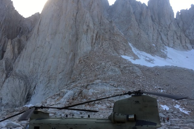 A U.S. Army CH-47F Chinook helicopter assigned to B Company, 1st Battalion, 126th Aviation Regiment, California Army National Guard, is on the ground near the peak of Mount Whitney in Inyo, California, after inserting search and rescue personnel to assist an injured hiker requiring hoist rescue, Aug. 25, 2019. The Cal Guard aircrew was activated by the California Governor's Office of Emergency Services to aid Inyo County Sheriff's Department with the high altitude rescue. At nearly 14,500 feet, Mount Whitney is the highest peak in the contiguous United States.