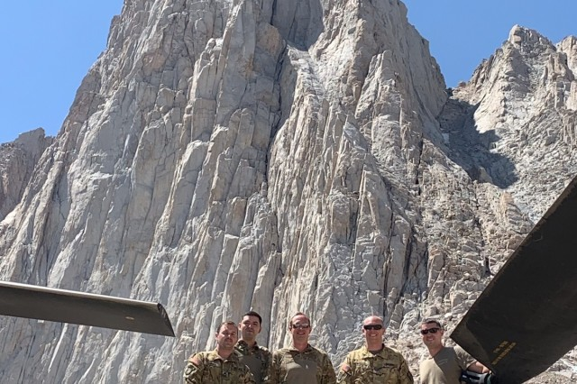 Crew members of a U.S. Army CH-47F Chinook helicopter assigned to B Company, 1st Battalion, 126th Aviation Regiment, California Army National Guard, are photographed while waiting for search and rescue personnel to return from assisting an injured hiker, Aug. 25, 2019, at Mount Whitney in Inyo County, California. The Chinook inserted a team from Inyo County Search and Rescue who provided aid to the woman and helped with her hoist rescue into the helicopter. From left: flight engineer and Sgt. Tyler Amador, crew chief and Spc. Engelberth Bonilla, the pilot in command and Chief Warrant Officer 2 Paul Mantiply, pilot and Chief Warrant Officer 2 Cody Weaver, and flight engineer and Sgt. Matt Hammond.