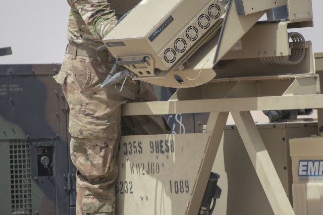 U.S. Army Reserve soldier Anthony Churches, a multichannel transmissions systems operator/maintainer assigned to Brave Company, 98th Expeditionary Signal Battalion, inspects a high powered amplifier attached to a Satellite Transportable Terminal on Camp Buehring, Kuwait, May 28, 2019. The 98th ESB conducted these exercises to prepare to set up a network if called up on a mission while deployed overseas. (U.S. Army photo by Spc. Matthew E. Drawdy)