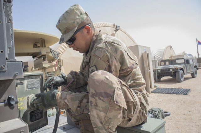 U.S. Army Reserve soldier Pfc. Bryan Ocha, a Multichannel Transmissions Systems Operator/Maintainer attached to Bravo Company, 98th Expeditionary Signal Battalion, runs power cables to a generator on April 4, 2019 at Camp Buehring, Kuwait. The 98th ESB conducted these exercises to prepare to set up a network if called up on a mission while deployed overseas. (U.S. Army photo by Spc. Matthew E. Drawdy)