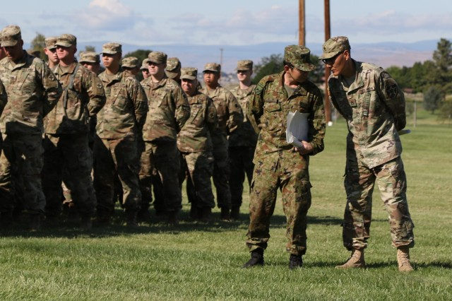 Translators from the Illinois Army National Guard and the Japan Ground Self-Defense Force discuss the Rising Thunder 2019 opening ceremony at Yakima Training Center, Washington, Aug. 30, 2019. Rising Thunder 2019 is an annual exercise joining the U.S. Army and the Japan Ground Self Defense Force (JGSDF) and is part of Pacific Pathways 19-3. Rising Thunder 2019 is also a United States Army Pacific-sponsored capstone event featuring U.S. Army units from the 7th Infantry Division and the Illinois Army National Guard's 33rd Infantry Brigade Combat Team and 108th Sustainment Brigade. The exercise includes company/platoon unilateral and bilateral training events in two phases, culminating with a bilateral live-fire exercise.
