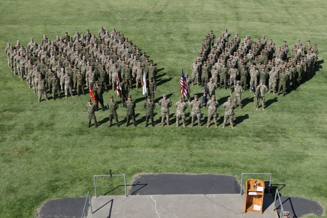 Soldiers of the Illinois Army National Guard and the Japan Ground Self-Defense Force stand in formation after the Rising Thunder 19 opening ceremony, held at Yakima Training Center, Washington, Aug. 30, 2019. Rising Thunder 2019 is an annual exercise joining the U.S. Army and the Japan Ground Self Defense Force (JGSDF) and is part of Pacific Pathways 19-3. Rising Thunder 2019 is also a United States Army Pacific-sponsored capstone event featuring U.S. Army units from the 7th Infantry Division and the Illinois Army National Guard's 33rd Infantry Brigade Combat Team and 108thSustainment Brigade. The exercise includes of company/platoon unilateral and bilateral training events in two phases, culminating with a bilateral live-fire exercise. (Photo by Army Reserve Sgt. Camacho Roberts)