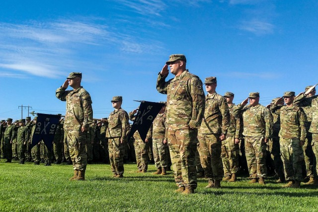 U.S. Soldiers with 2-130th Infantry Regiment, 33rd Infantry Brigade Combat Team, Illinois Army National Guard, render the salute during the opening ceremony of Rising Thunder 19 at Yakima Training Center, Yakima, Wash., Aug. 30, 2019. Rising Thunder 2019 is an annual exercise joining the U.S. Army and the Japan Ground Self Defense Force (JGSDF) and is part of Pacific Pathways 19-3. Rising Thunder 2019 is also a United States Army Pacific-sponsored capstone event featuring U.S. Army units from the 7th Infantry Division and the Illinois Army National Guard's 33rd Infantry Brigade Combat Team and 108thSustainment Brigade. The exercise includes company/platoon unilateral and bilateral training events in two phases, culminating with a bilateral live-fire exercise. (U.S. Army Reserve photo by Capt. Troy Preston)