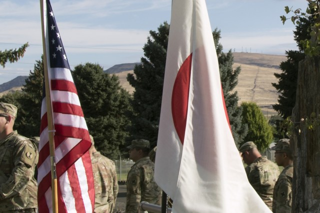Yakima, WA - The American and Japanese flag flies during the opening ceremony of Rising Thunder 2019 hosted by the 7th Infantry Division at Yakima Training Center in Yakima, Washington, August 30, 2019.. Rising Thunder 2019 is an annual exercise between the U.S. Army and the Japan Ground Self Defense Force (JGSDF) and is part of Pacific Pathways 19-3. RT19 is a USARPAC-sponsored capstone event. U.S. Army Units participating include 7th Infantry Division, 33rd IBCT from Illinois National Guard. The exercise consists of company/platoon unilateral and bilateral training events in two phases, culminating with a bilateral LFX. (U.S. Army Reserve photo by Sgt. Jeff Daniel)