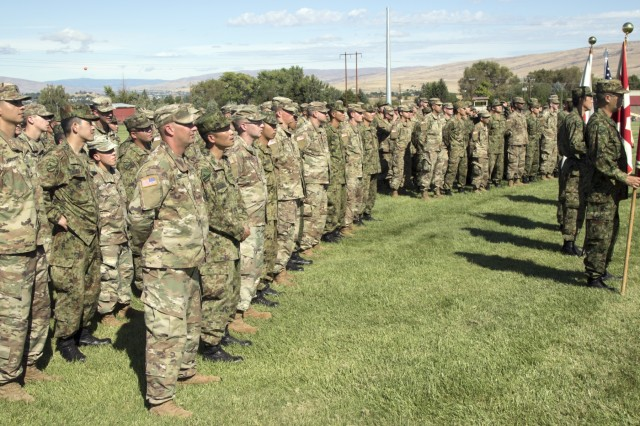 Yakima, WA - U.S and Japanese soldiers attend the opening ceremony of Rising Thunder 2019 hosted by the 7th Infantry Division at Yakima Training Center in Yakima, Washington, August 30, 2019.. Rising Thunder 2019 is an annual exercise between the U.S. Army and the Japanese Ground Self Defense Force (JGSDF) and is part of Pacific Pathways 19-3. RT19 is a USARPAC-sponsored capstone event. U.S. Army Units participating include 7th Infantry Division, 33rd IBCT from Illinois National Guard. The exercise consists of company/platoon unilateral and bilateral training events in two phases, culminating with a bilateral LFX. (U.S. Army Reserve photo by Sgt. Jeff Daniel)