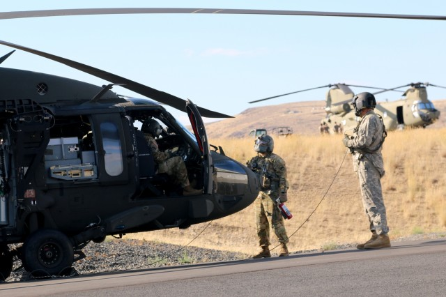 Soldiers with the 16th Combat Aviation Brigade instruct on evacuation training as part of Rising Thunder 2019 at Yakima Training Center in Yakima, Washington, August 30, 2019. Rising Thunder 2019 is an annual exercise between the U.S. Army and the Japan Ground Self-Defense Force (JGSDF) and is part of Pacific Pathways 19-3. RT19 is a USARPAC-sponsored capstone event. U.S. Army Units participating include the 7th Infantry Division and the Illinois Army National Guard's 108th Sustainment Brigade and 33rd Infantry Brigade Combat Team. The exercise consists of company/platoon unilateral and bilateral training events in two phases, culminating with a bilateral live-fire exercise. (U.S. Army photo by Spc. Shaylin Quaid)