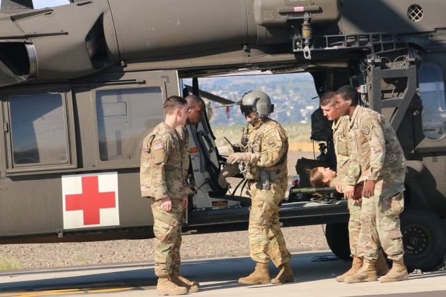 Soldiers with the 16th Combat Aviation Brigade provide medevac training to Illinois Army National Guard Soldiers from the 1844th Transportation Company as part of Rising Thunder 2019 at Yakima Training Center in Yakima, Washington, August 30, 2019. Rising Thunder 2019 is an annual exercise between the U.S. Army and the Japan Ground Self-Defense Force (JGSDF) and is part of Pacific Pathways 19-3. RT19 is a USARPAC-sponsored capstone event. U.S. Army Units participating include the 7th Infantry Division and the Illinois Army National Guard's 108th Sustainment Brigade and 33rd Infantry Brigade Combat Team. The exercise consists of company/platoon unilateral and bilateral training events in two phases, culminating with a bilateral live-fire exercise. (U.S. Army photo by Spc. Shaylin Quaid)