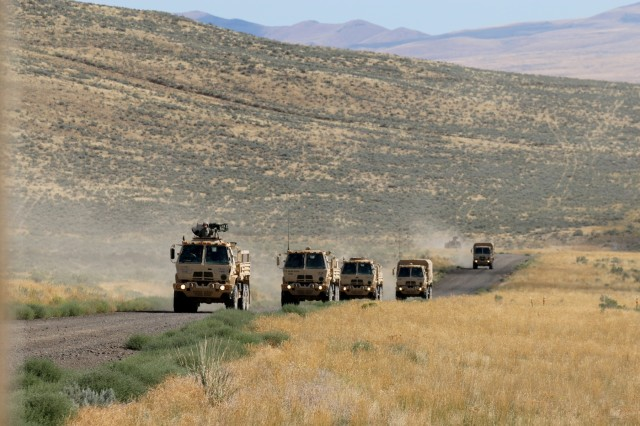 Illinois Army National Guard Soldiers from the 1844th Transportation Company convoy to their IED lane training as part of Rising Thunder 2019 at Yakima Training Center in Yakima, Washington, August 30, 2019. Rising Thunder 2019 is an annual exercise between the U.S. Army and the Japan Ground Self-Defense Force (JGSDF) and is part of Pacific Pathways 19-3. RT19 is a USARPAC-sponsored capstone event. U.S. Army Units participating include the 7th Infantry Division and the Illinois Army National Guard's 108th Sustainment Brigade and 33rd Infantry Brigade Combat Team. The exercise consists of company/platoon unilateral and bilateral training events in two phases, culminating with a bilateral live-fire exercise. (U.S. Army photo by Spc. Shaylin Quaid)