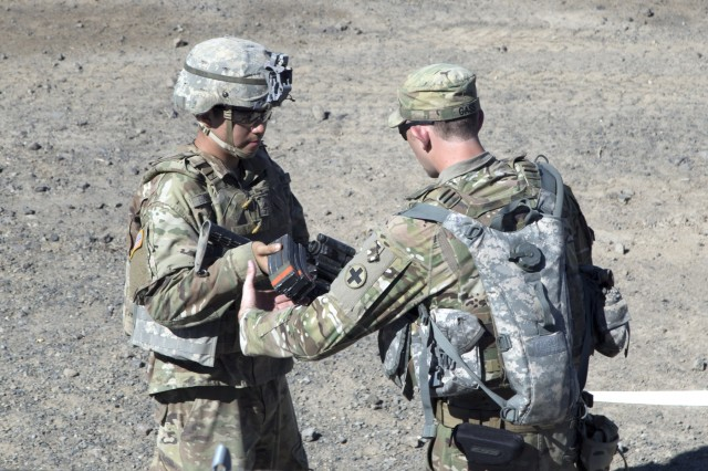 Yakima, WA - A soldier with the 178th Infantry Regiment has ammunition handed to him for weapons qualification during Rising Thunder 2019 hosted by the 7th Infantry Division at Yakima Training Center in Yakima, Washington, September 1, 2019.. Rising Thunder 2019 is an annual exercise between the U.S. Army and the Japanese Ground Self Defense Force (JGSDF) and is part of Pacific Pathways 19-3. RT19 is a USARPAC-sponsored capstone event. U.S. Army Units participating include 7th Infantry Division, 33rd IBCT from Illinois National Guard. The exercise consists of company/platoon unilateral and bilateral training events in two phases, culminating with a bilateral LFX. (U.S. Army Reserve photo by Sgt. Jeff Daniel)