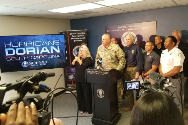 U.S. Army Maj. Gen. Van McCarty, the adjutant general for South Carolina, provided an update on the South Carolina National Guard in response to Hurricane Dorian during a press conference with South Carolina Gov. Henry McMaster, Sept. 1, 2019. Approximately 1,000 South Carolina National Guard Soldiers and Airmen have reported to their units throughout the state to provide support to state partners. The South Carolina National Guard is ready to support the counties and first responders with whatever resources they need for as long as needed before, during, and after the impact of Hurricane Dorian to South Carolina. (U.S. Army National Guard photo by Capt. Jessica Donnelly)