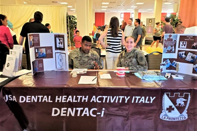 Pfc. Jaron Ricks (left) and Spc. Alexis Turley (right) from the Vicenza Dental Clinic participated in the USAG Italy Career and Volunteer Fair held at Caserma Ederle recently.  The Soldiers provided information and answered questions about job and volunteer opportunities at the Vicenza Dental Clinic.